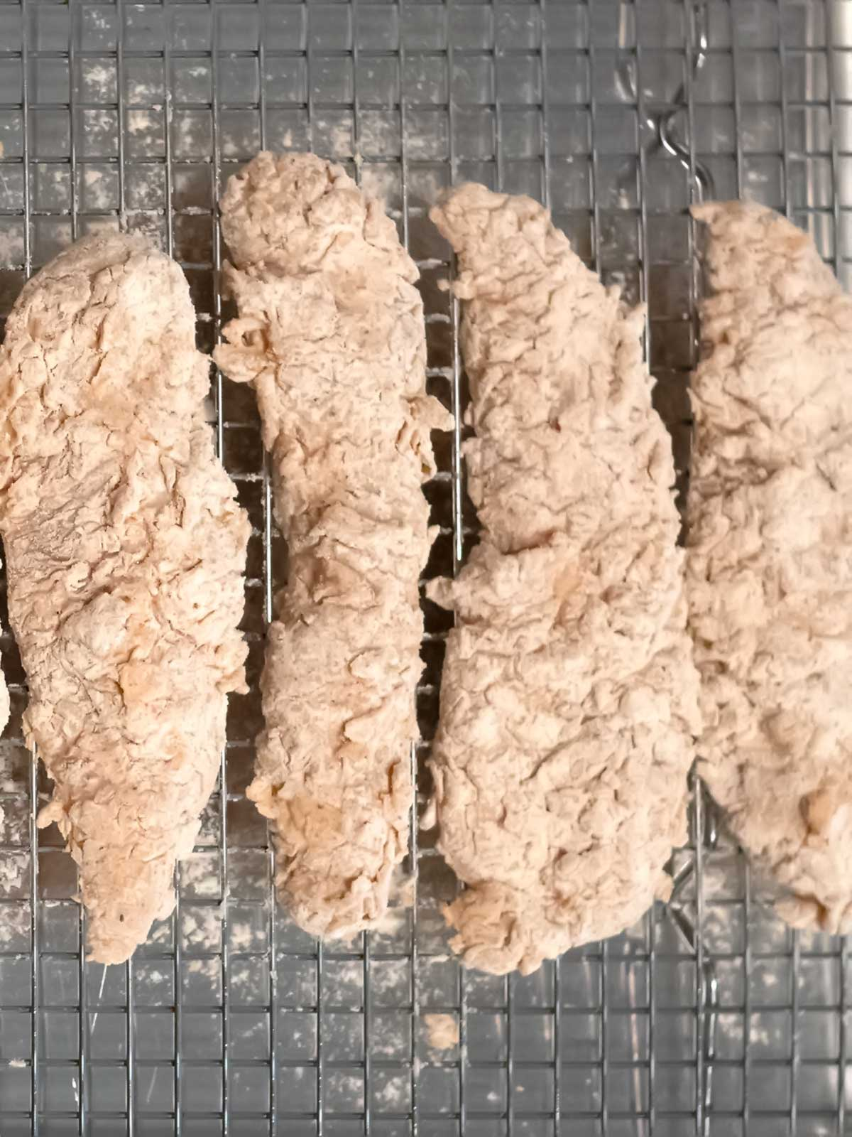 Coated chicken strips on wire rack
