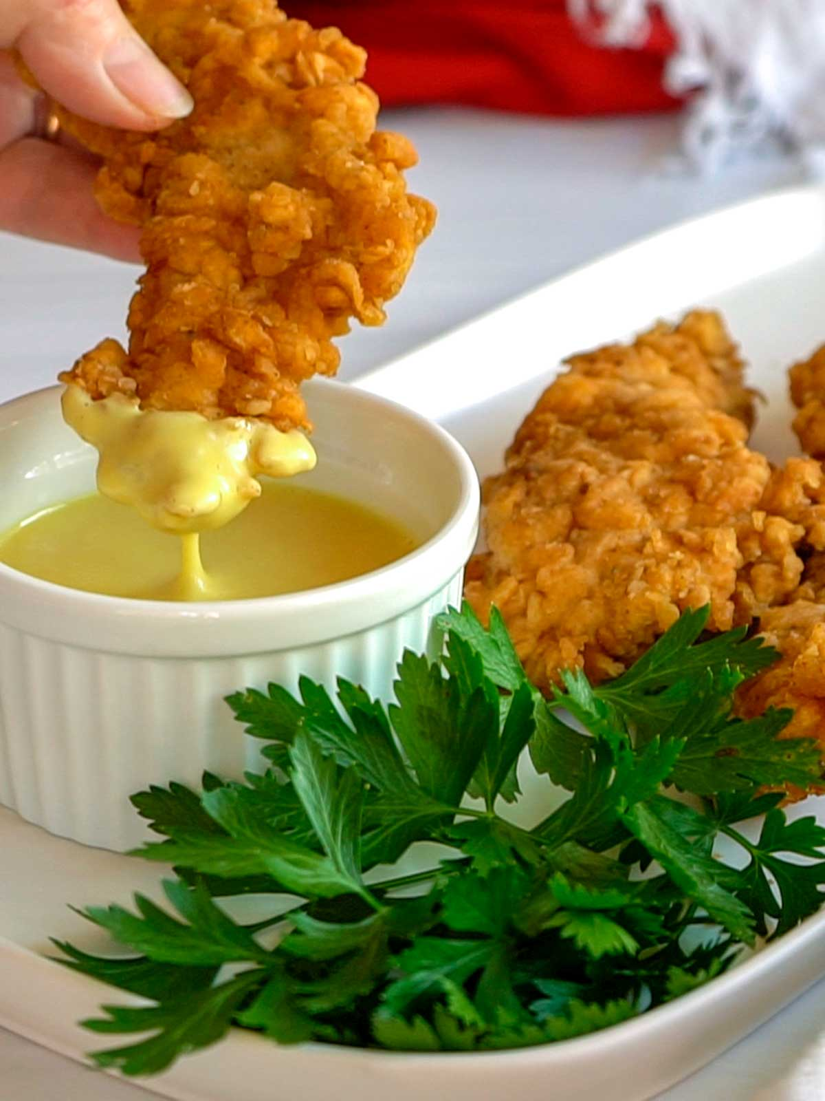 Dipping Southern Fried Chicken Strips in Honey Mustard Dipping Sauce