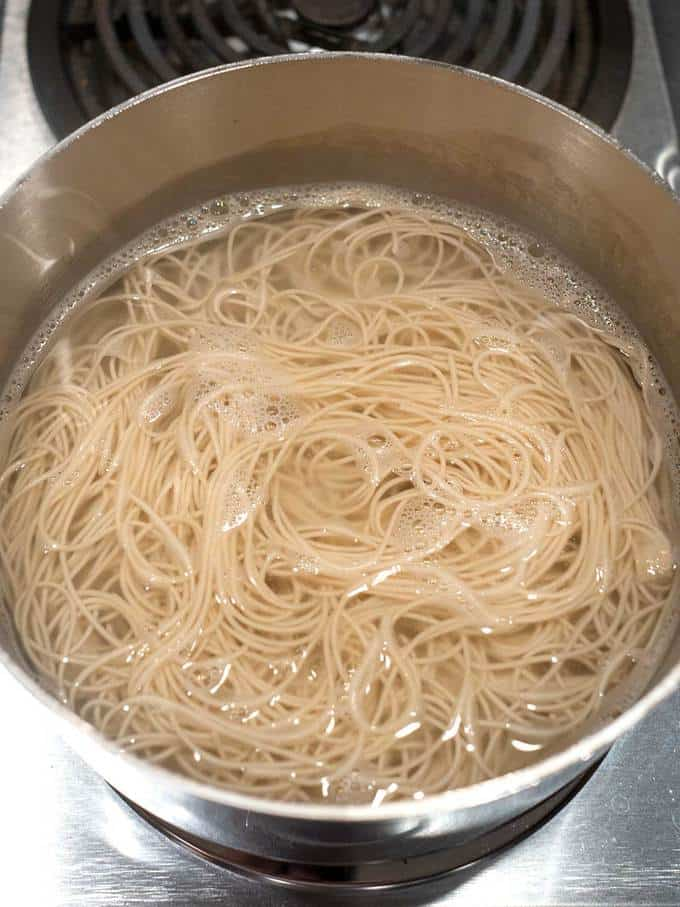 Cooking noodles in boiling water