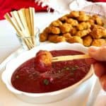 Dipping Sausage Balls in Cranberry Honey Mustard Dipping Sauce