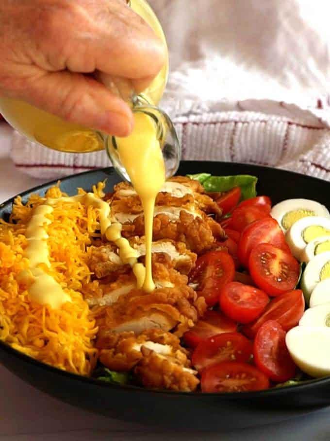 Pouring Honey Mustard Dressing on Salad