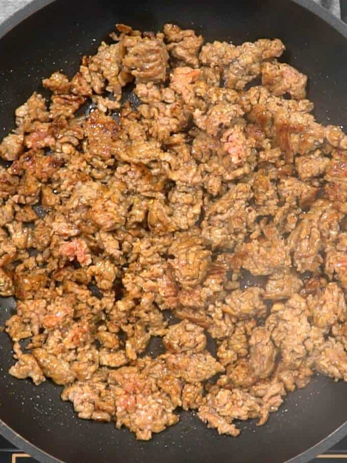 Cooked Italian sausage in skillet