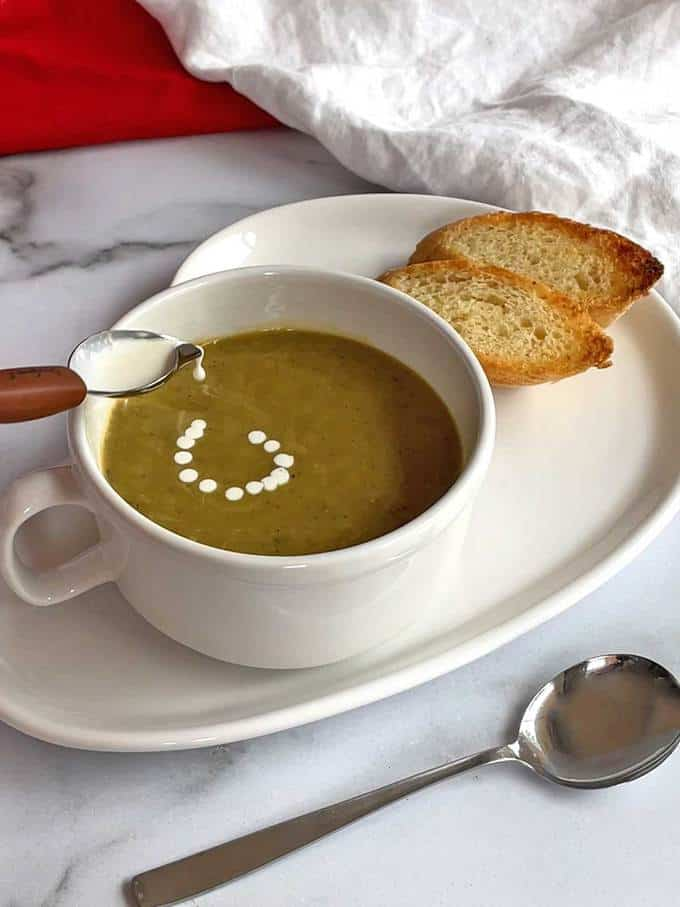 Serving Split Pea Soup with Smoked Sausage