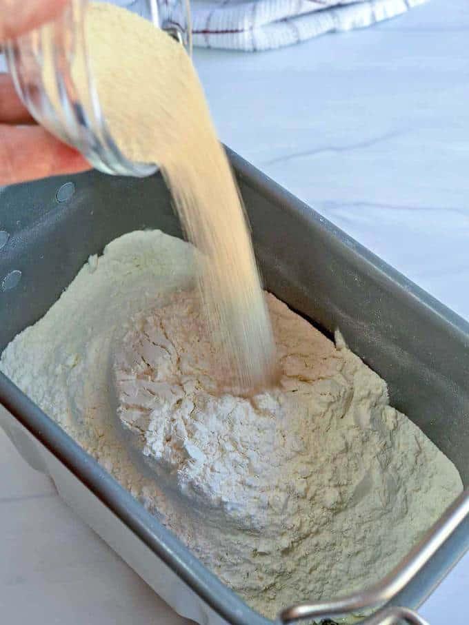 Adding yeast to bread machine pan