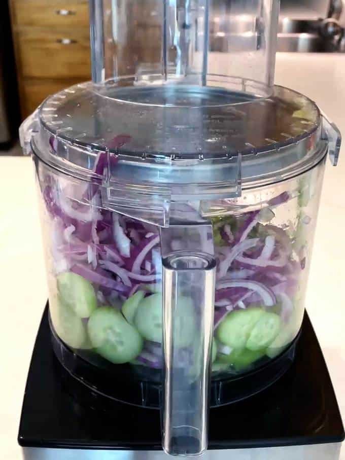 Slicing the cucumber and onion in food processor
