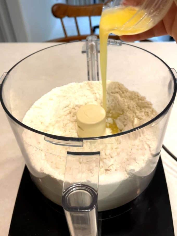 Adding butter to food processor