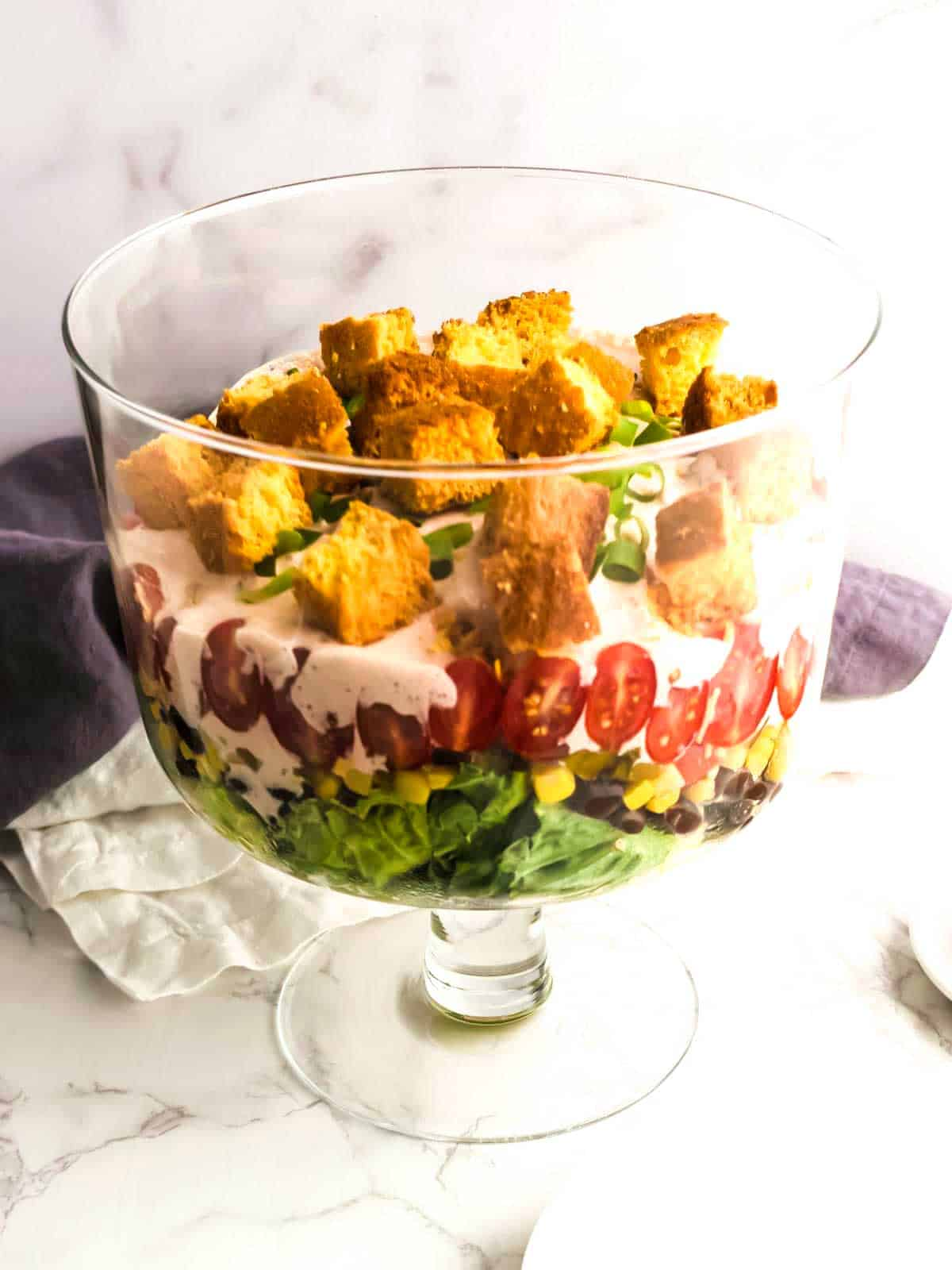 Salad topped with cornbread croutons