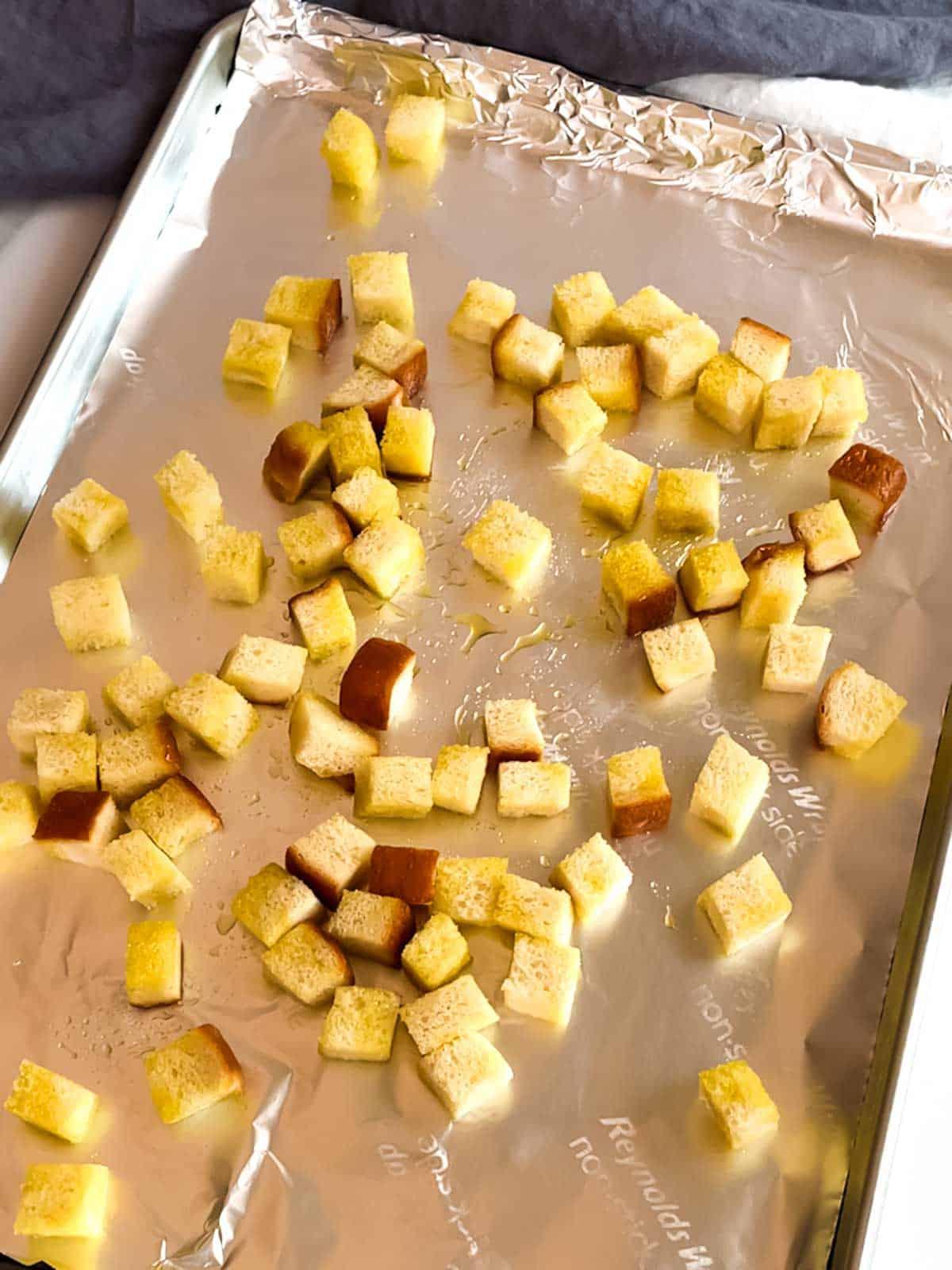 Croutons on baking sheet