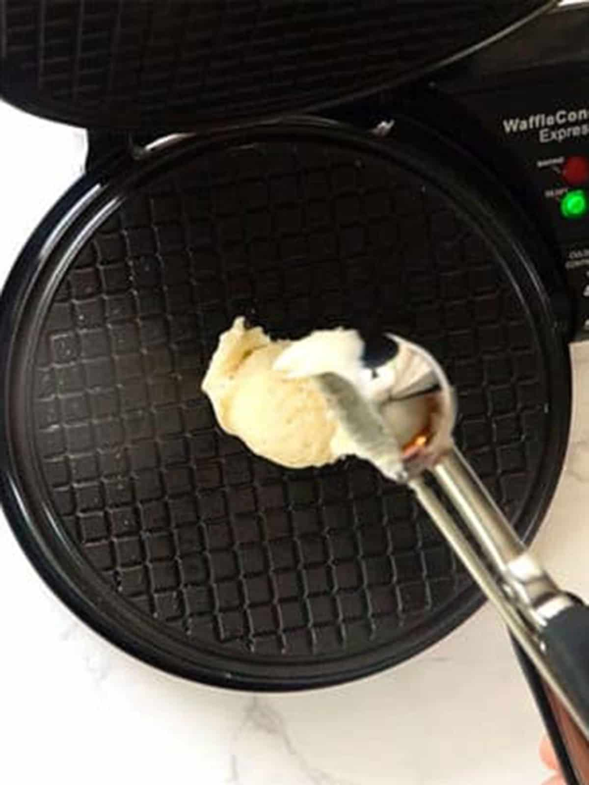 Adding waffle batter to waffle iron