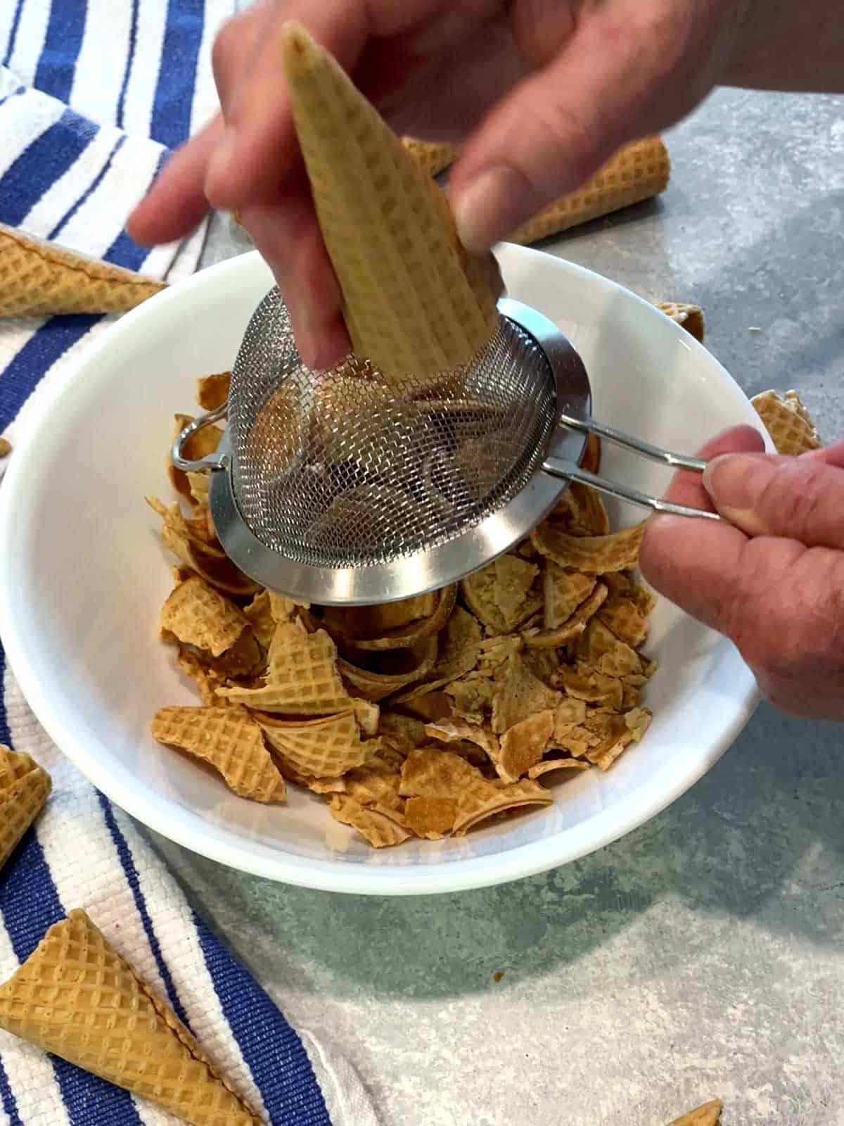 Sanding the rough edges of the cut down sugar cone