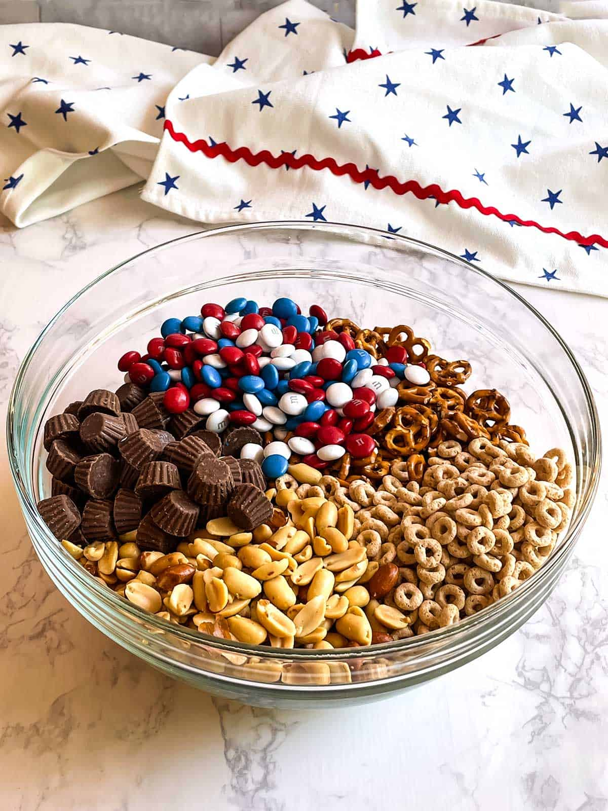 Snack mix ingredients in a large bowl.