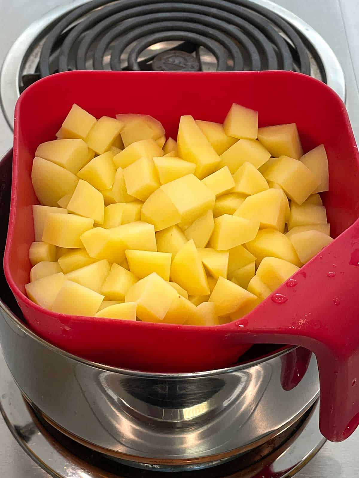 Draining the potatoes.
