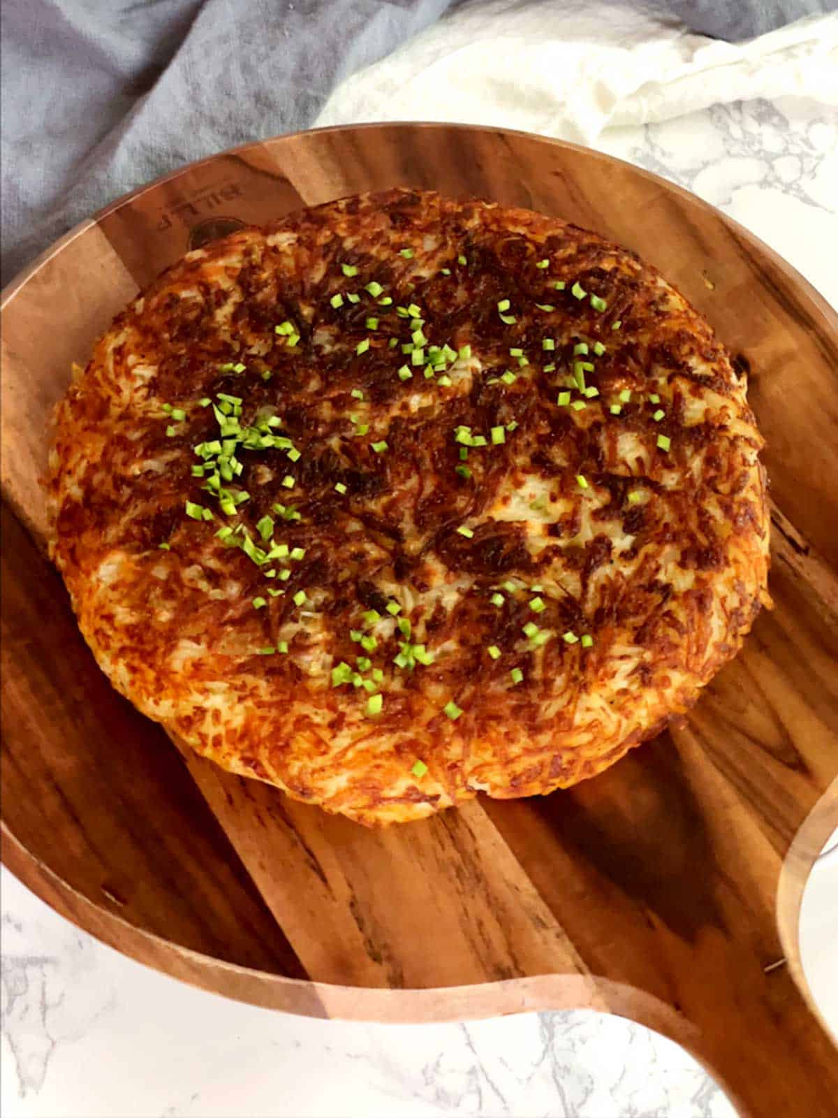 Grated Potato galette on cutting board
