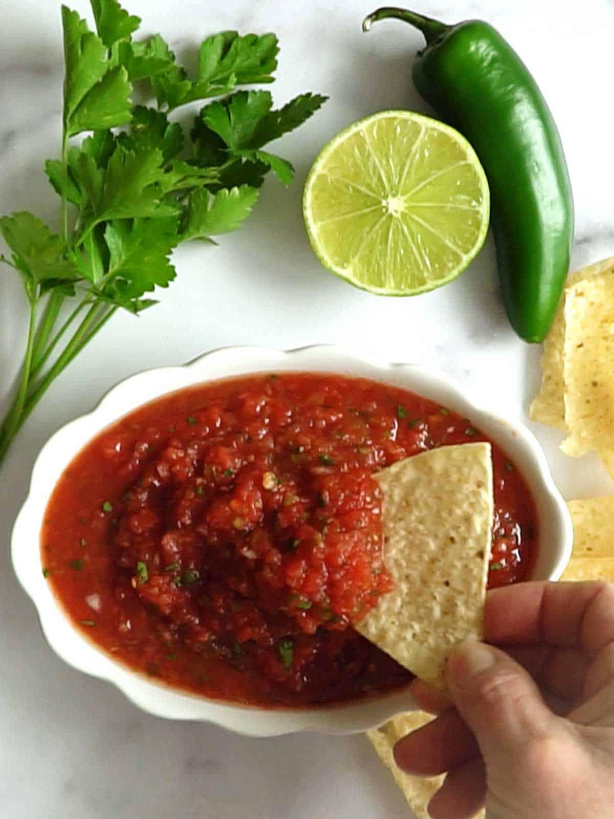 Restaurant Style salsa with tortilla chip.