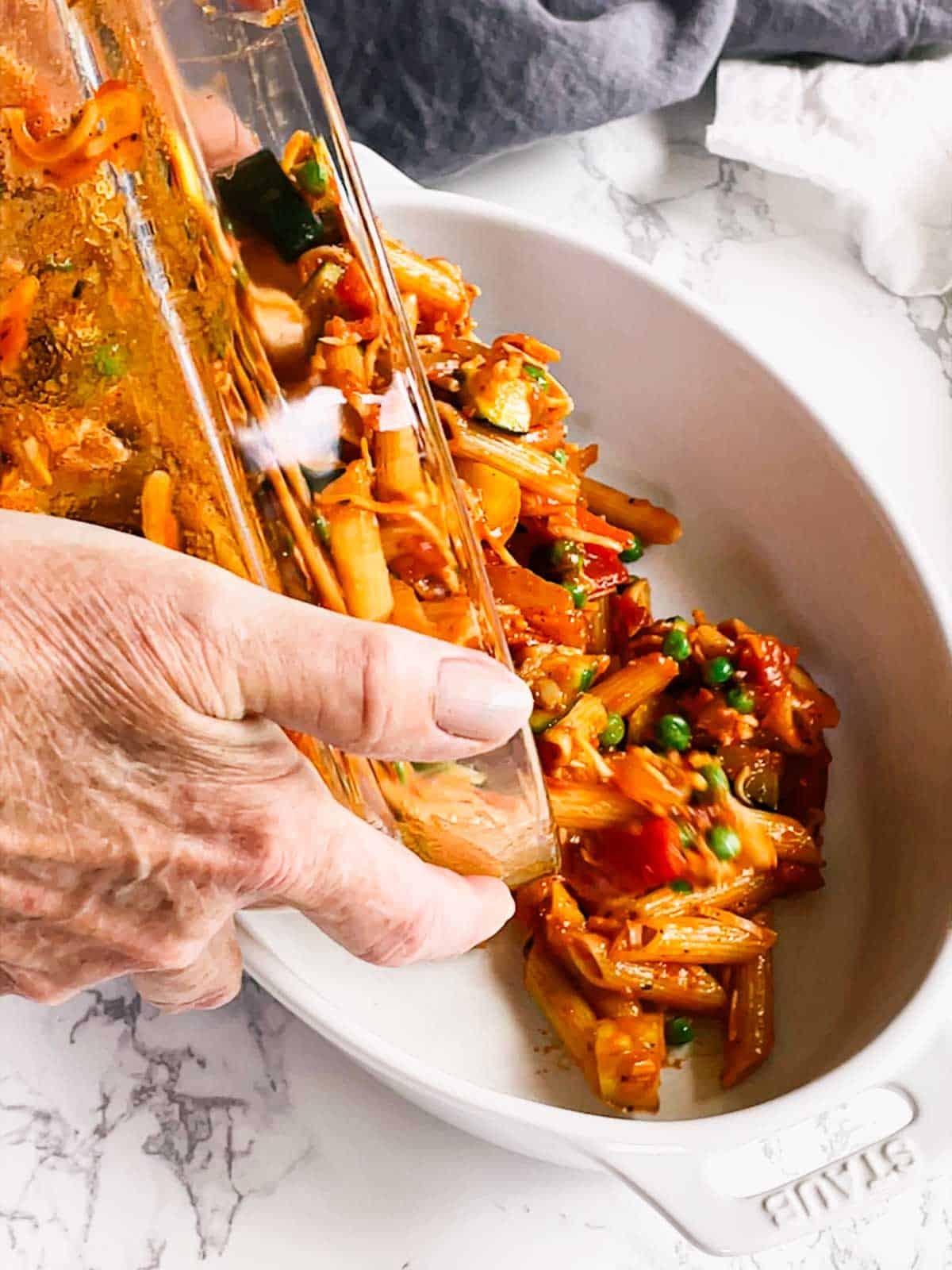 Transferring mixture to prepared casserole dish.