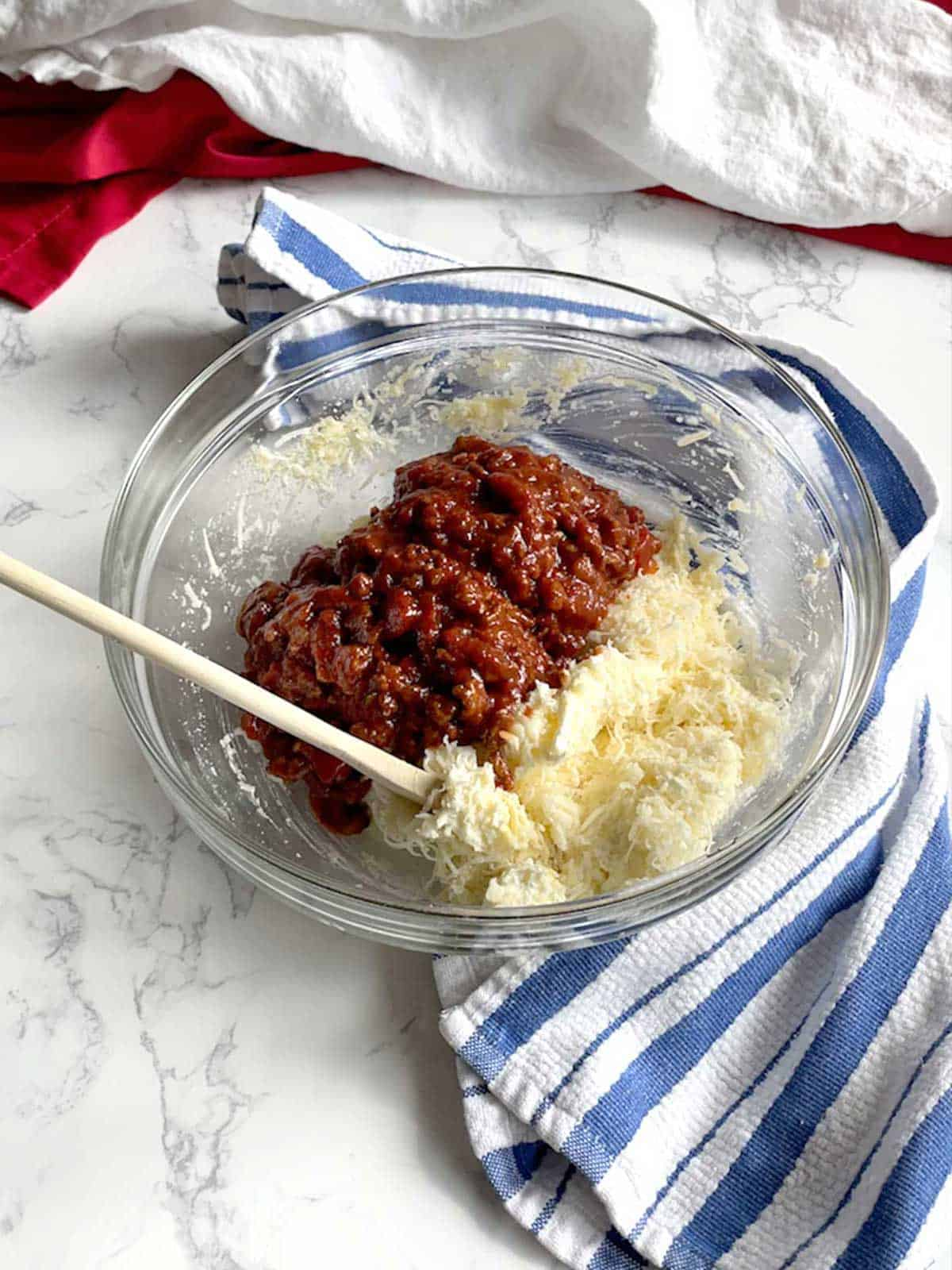 Meat Sauce added to three cheese mixture.