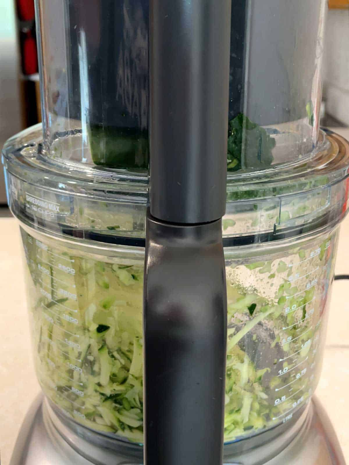 Grating zucchini and onion in food processor