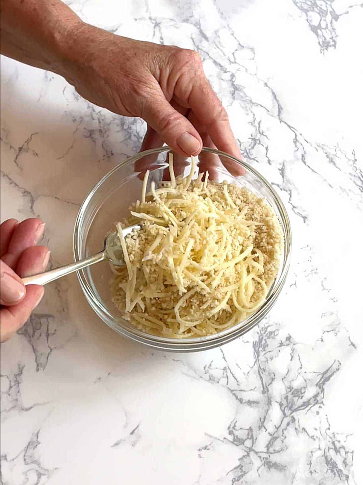Mixing cheese and panko breadcrumbs