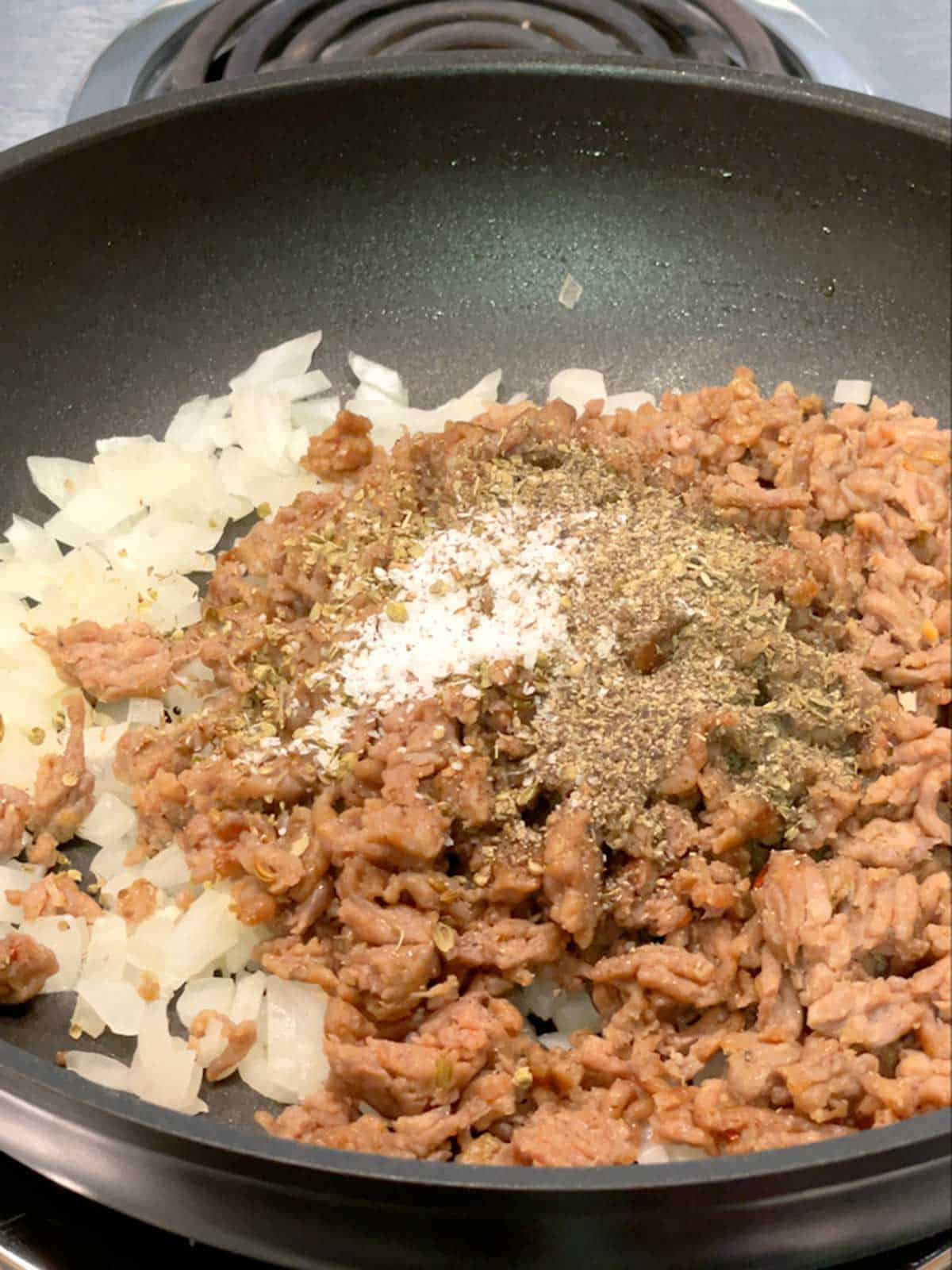 Onions and garlic with sausage, spices, salt and pepper added.