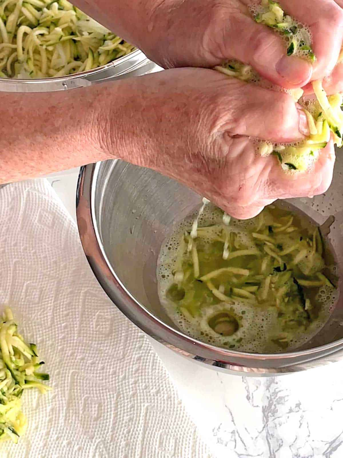 Squeezing liquid from grated zucchini and onion
