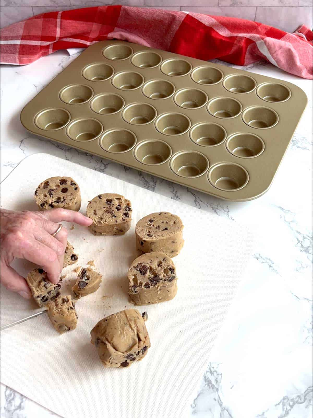 Cutting cookie dough rounds into four pieces.