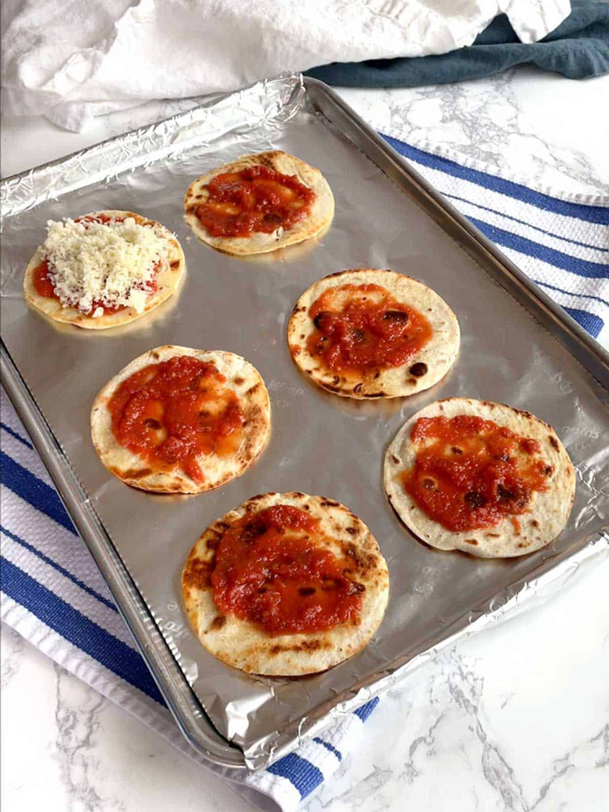 Mini Pizzas ready for oven