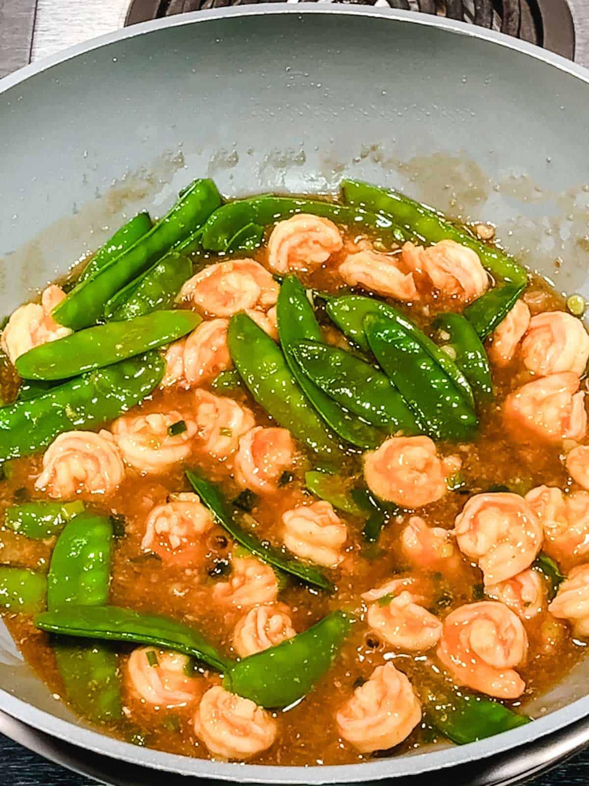 Stir Fry Shrimp with Snow Peas ready to serve.